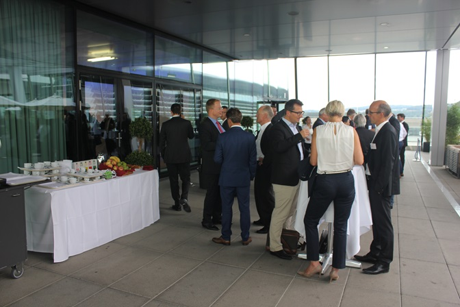 Outside view of the event, participants standing around (small buffet)