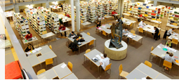 View of the workplaces and bookshelves within the university library from a bird's eye perspective.